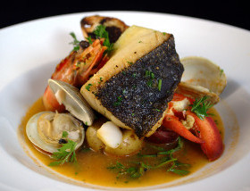 Black Cod Bouillabaisse with Lobster, Clams, Skull Island Prawn, Sea Bean at 1700 Degrees Steakhouse in Harrisburg