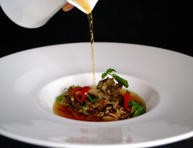 Consommé with Crispy Chicken Thigh, Pequillo Pepper, Barley, Miatake, Mint at 1700 Degrees Steakhouse in Harrisburg