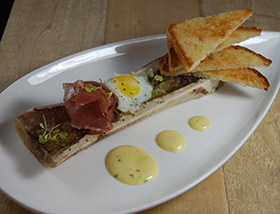 "Bone Marrow ""Benedict"" with Sunny Side Quail Egg, Prosciutto, Hollandaise, Toasted Nooks and Crannies. Dinner at 1700 Degrees Steakhouse in Harrisburg, PA"