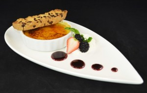 Vanilla Crème Brulee with House Biscotti, Fresh Fruit. Dessert at 1700 Degrees Steakhouse in Harrisburg