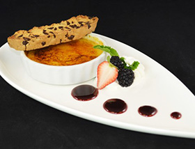 Vanilla Crème Brulee with House Biscotti, Fresh Fruit at 1700 Degrees Steakhouse in Harrisburg, PA