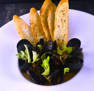P.E.I. Mussels with Boar Sausage, Black Garlic, Charred Carrot, Leek, Albarino at 1700 Degrees Steakhouse in Harrisburg PA