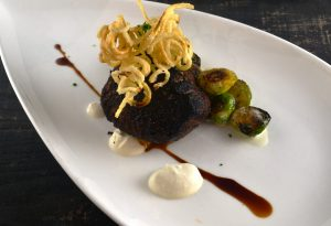 Steak prepared with Roasted Sprouts, Horseradish Cream, Crispy Potatoes at 1700 Degrees Steakhouse in Harrisburg PA